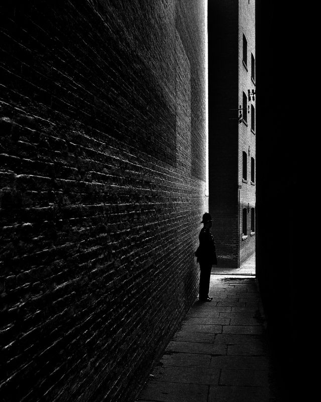 Here is a photo by Bill Brandt called 'copper' I like this photo as it is so mysterious and dark. I find it mysterious and dark because it makes me wonder why a policemen is down what looks like a threatening ally way just standing there.