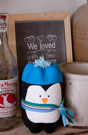 I love penguins and this is such a cute craft to make with the kids! It uses plastic soda bottles, so it is a great craft to teach recycling as well. Grab those empty bottles a make a huddle of penguins for your mantle this winter. Decorate your house with him for the last 6 weeks of winter!