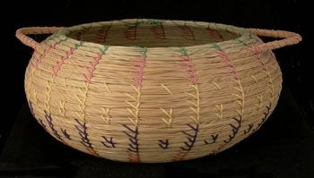 """SEMINOLE SWEETGRASS BASKET - """"Sweetgrass"""" baskets have been made by Seminole Indians for more than 60 years. The wild sweetgrass used in these beautiful, sturdy creations is hand-picked from high, dry areas of the Everglades basin, washed, laid in the sun to dry and sewn together with colored threads. Palmetto fiber is the usual basket base material. The baskets may take many different shapes. The Seminole Tribe of Florida."""