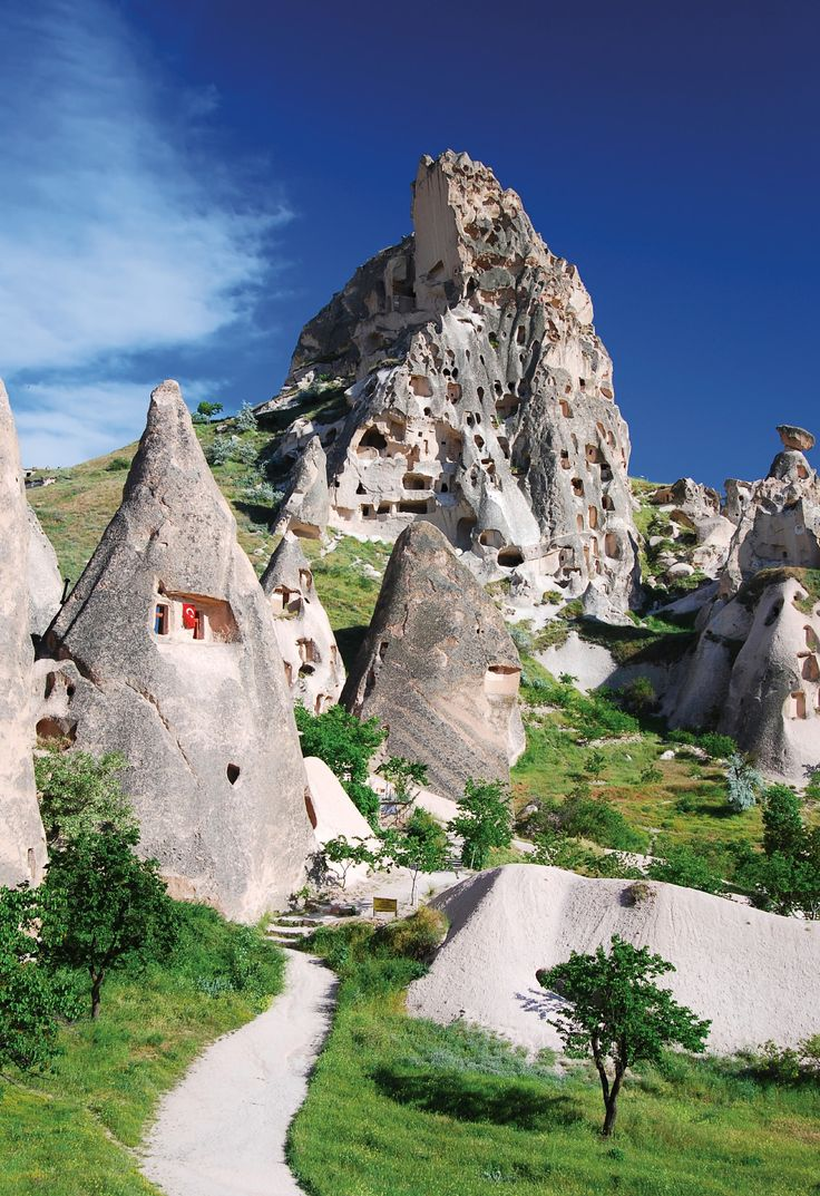 The Cave Cities of Cappadocia, Turkey There are two hotels that are made in the caves. Really cool.... would be nice to try!