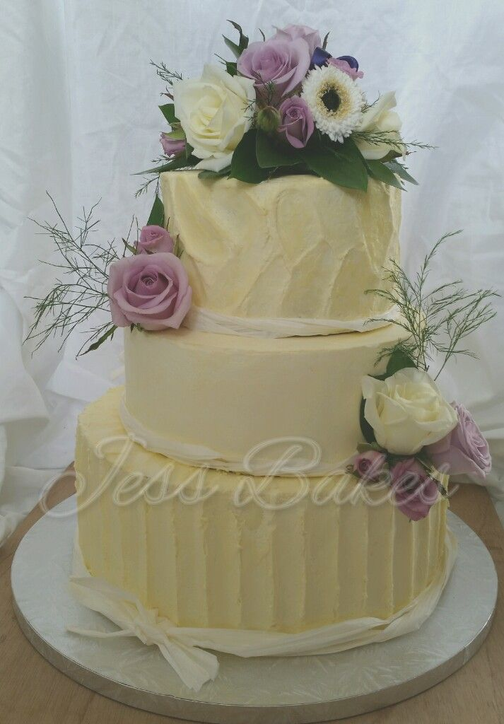 A rustic buttercream cake with fresh flowers and raffia. It has three tiers; one chocolate, one vanilla and one special one... ube  (oo-bee) which is a purple yam grown in the Phillipines and ...