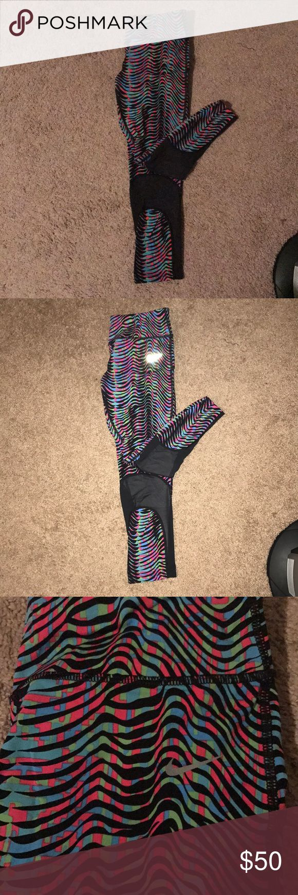 Nike running leggings Tight Nike running leggings. Has sheer potion in calf. Can model upon request. One of my fav pairs of leggings, but trying to spring clean. Funky color pattern, nice switch up from the classic black leggings. Nike Pants Leggings