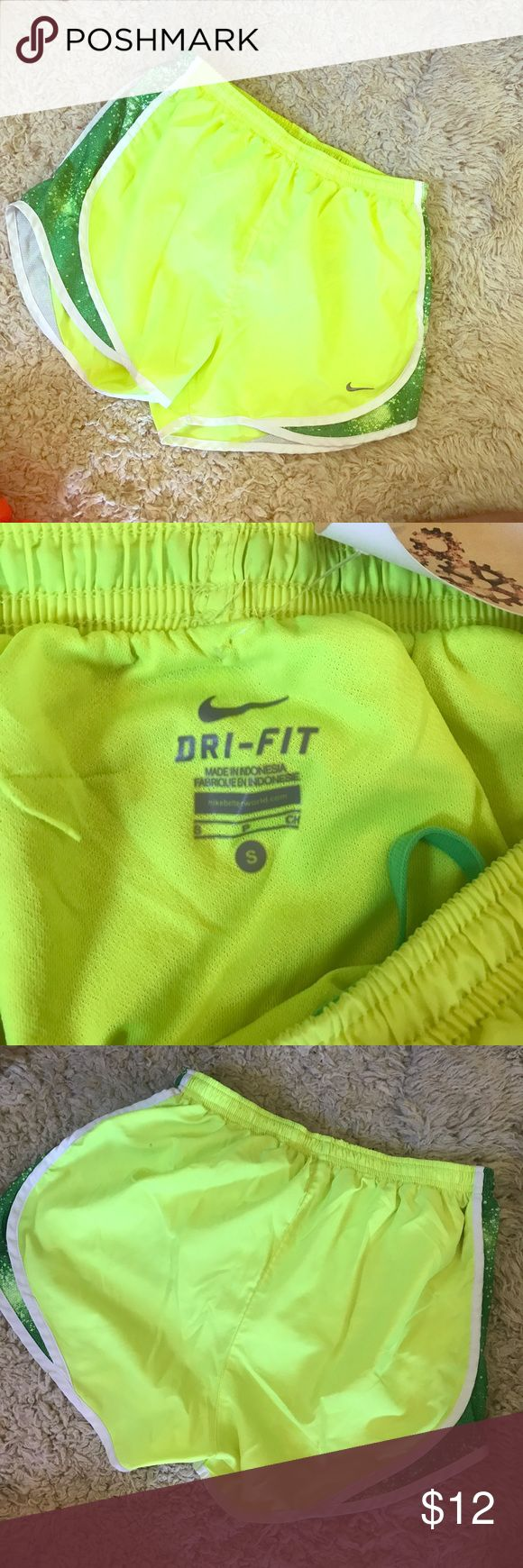 ⚡️ Electric ⚡️ Green Nike Dri Fit Shorts A beautiful lemon-lime color that anyone will see from a mile away! The neon helps you look tanner, while I work on maintaining your summer bod! Small stain size of a pen tip on backside (see in last photo). Great deal for great workout gear! Nike Shorts