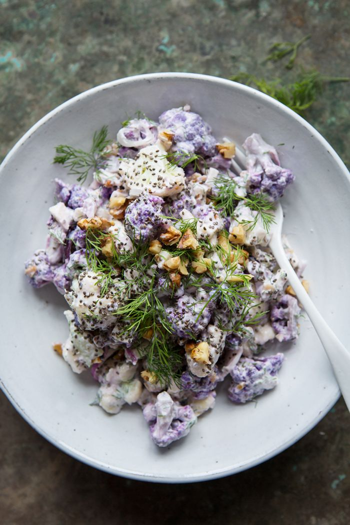 A raw cauliflower salad with horseradish, dill and yoghurt dressing