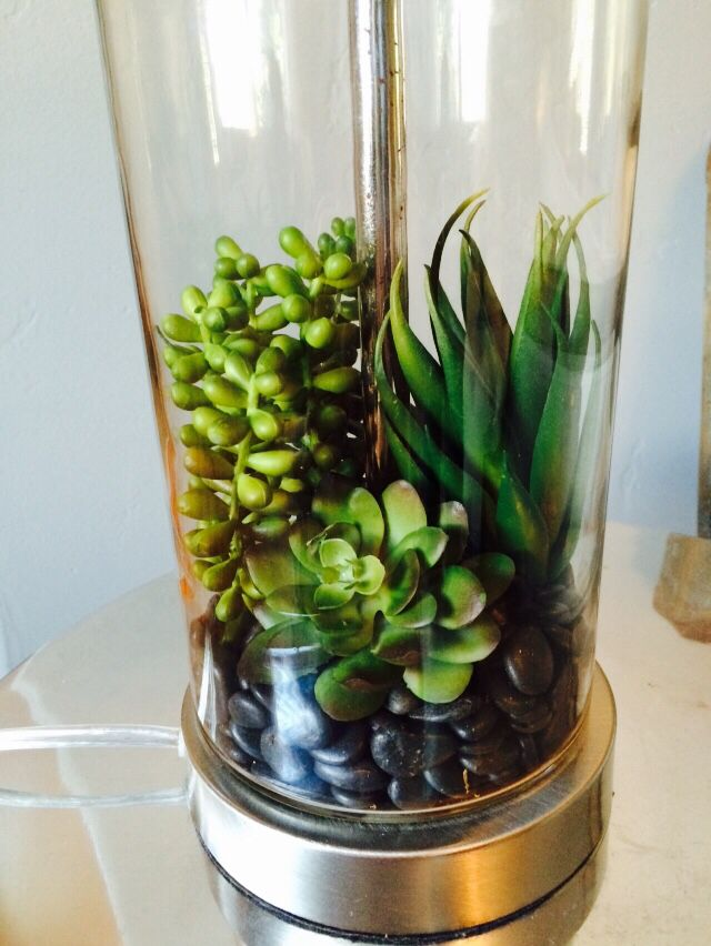 Fake Succulents And Black Pebbles Inside A Fillable Lamp Base So