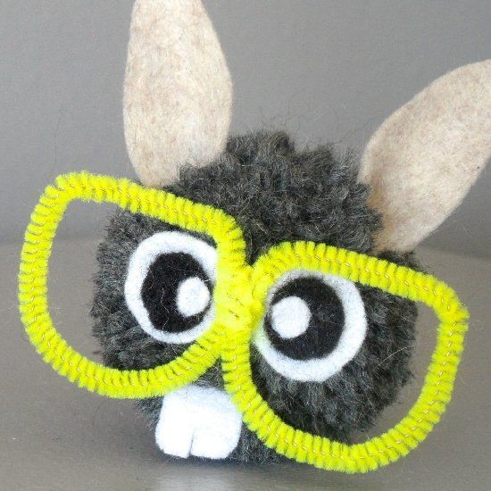 All you need is a yarn pom pom, scrap felt and a pipe cleaner to make an adorable funny bunny.  :)
