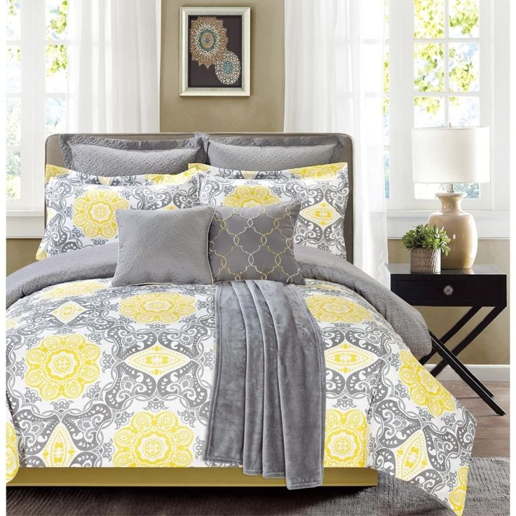 Bring some sunshine to your bedroom with this seven-piece, printed comforter set with a plush throw.