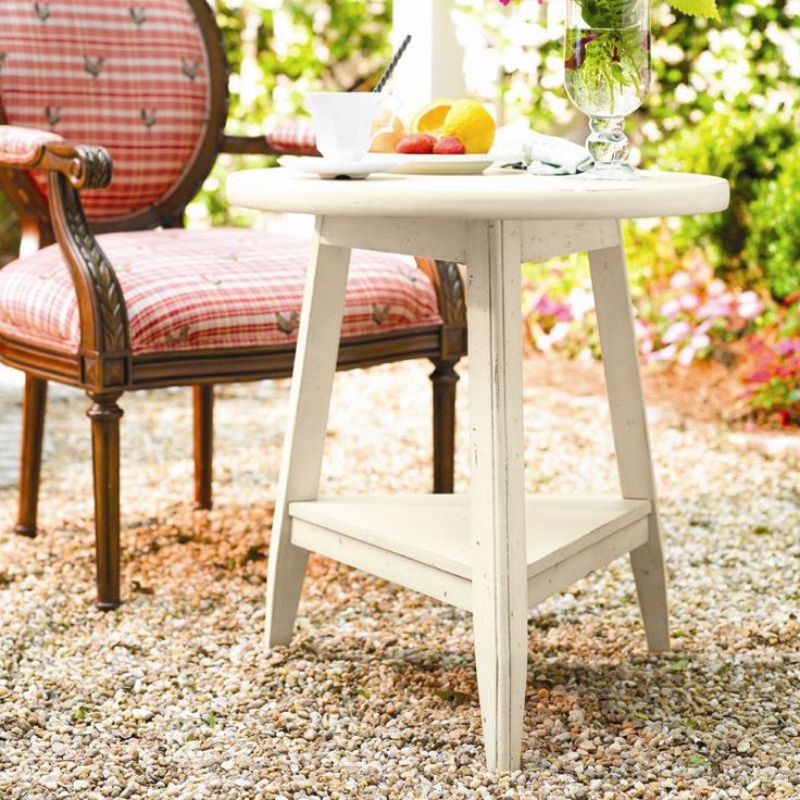 Weathered End Table With A Tripod Silhouette.Product: End TableConstruction  Material: WoodColor: LinenFeatures:Part Of The Paula Deen Home Collection  ...