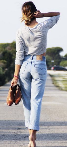 Casual Friday. Blogger Rocío Osorno wears vintage Levi's with a grey pullover sweatshirt and tan booties.