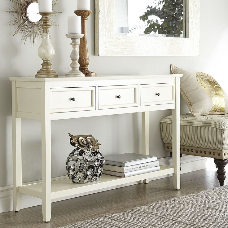Strong, silent type. Simultaneously bold and low-key, sporting simple lines, a masterful pairing of smooth engineered wood and liberally grained kiln-dried hardwood with applied molding. Classic white color. Three large drawers and full-length storage shelf. Practical, sturdy and downright handsome. (Wow, and to think you two met online.)