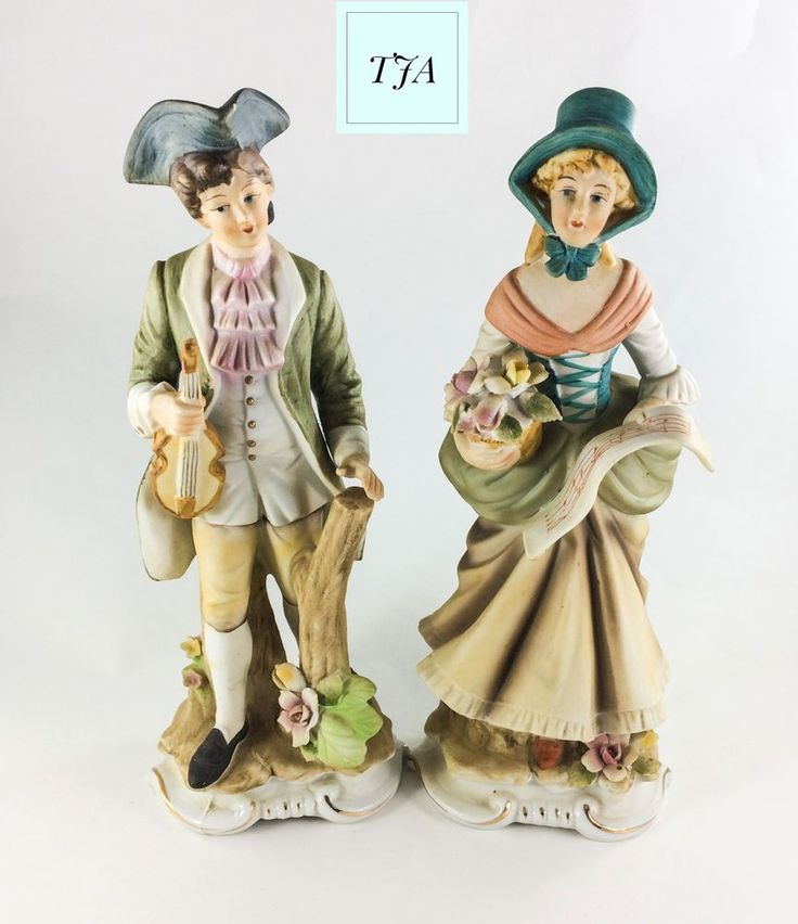 Vintage Ceramic Couple singing Music.  Both stand 9 1/2 inches tall.   Made of ceramic material.  Both are dressing in Victorian style clothing and decorated with flowers and tree stumps. Man is holding a violin and the lady has flowers and a sheet of music.  Both painted in light colors of green, yellow, pink and orange.