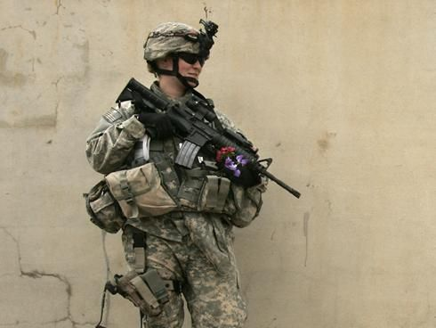 An American female soldier takes part in a house-by-house search on April 16, 2007, in Mosul, Iraq.