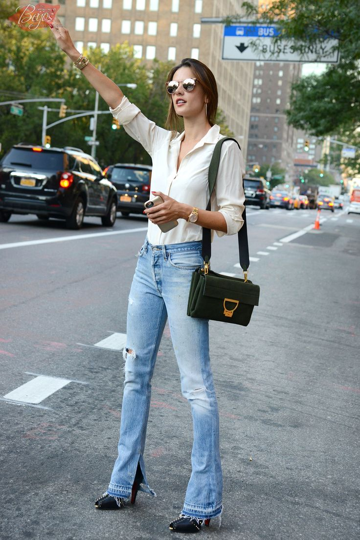 Alessandra Ambrosio radiated casual chic as she hailed a taxi on a city street - September 17, 2015 New York City, NY