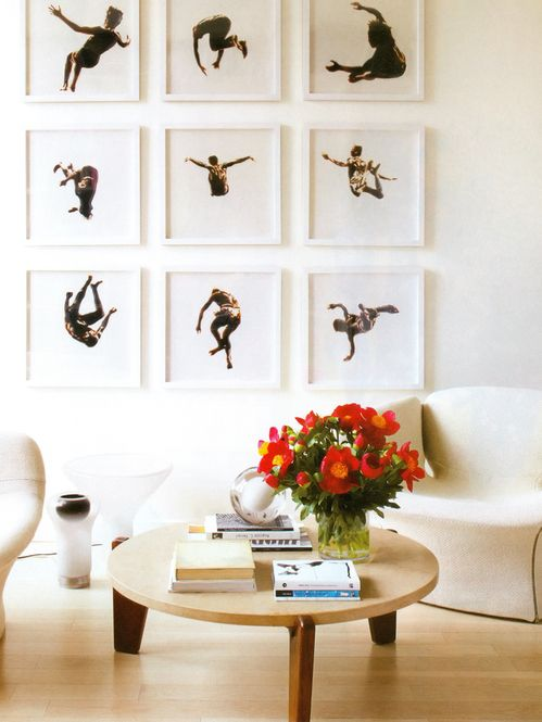 Gallery wall with dancers. Love this! How can anyone look away? White frames support the photo backdrop so the focus is all about the dancers and  movement... Even better as a series!