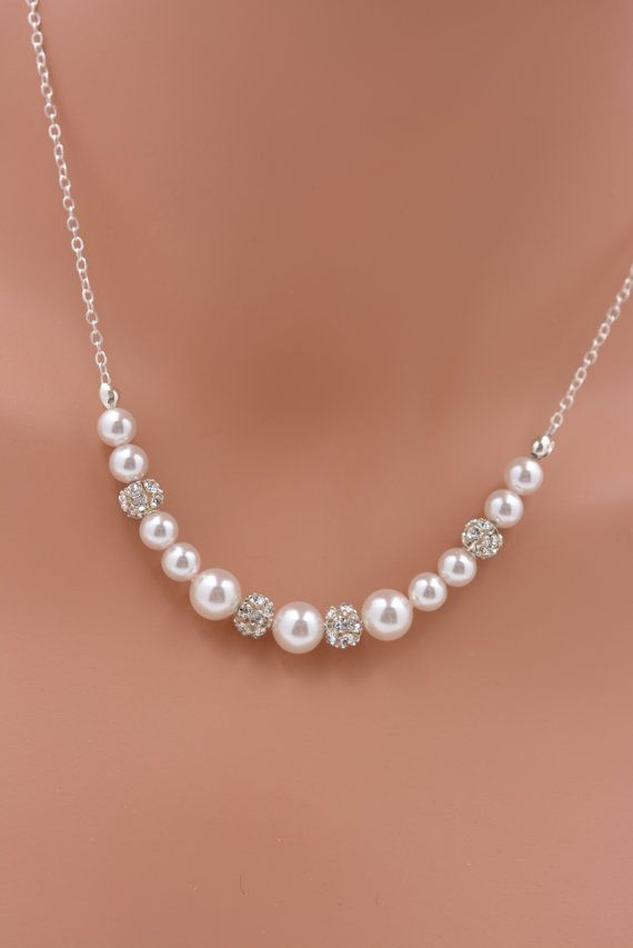 This lovely necklace features 8mm and 6mm white Swarovski pearls (5 colors available) alternated with silver plated rhinestone beads. The
