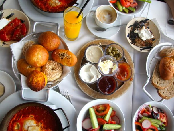 Israeli Breakfast. A large and glorious breakfast tradition that began w/kibbutz workers who'd work in the field before dawn and were ravenous by 7 am. #Recipes for Shakshouka, Bourekas, Hummus, and Baba Ghanoush.