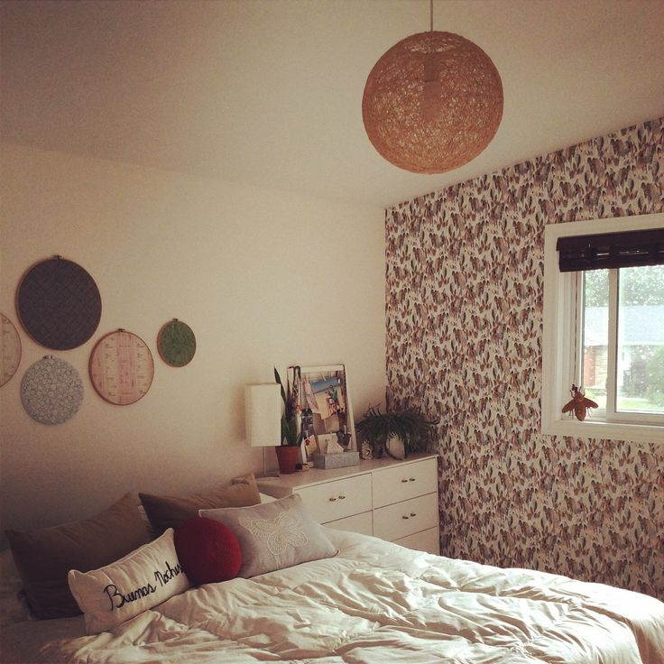 Wallpapered our bedroom wall with a beautiful feather motif from Graham and Brown online. Super pleased with the results!