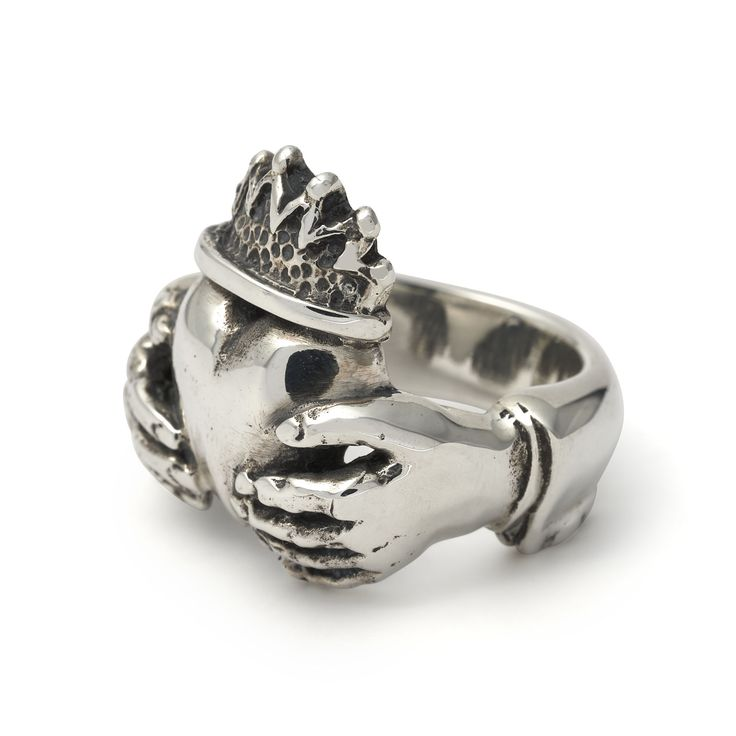 The Claddagh ring is a traditional Irish ring representing love (the heart), loyalty (the crown) and friendship (the hands). This is our take on it; a chunky and solid piece made from British hallmarked .925 sterling silver. Height: 22mm Width: 27mm Approximate Weight: 21g