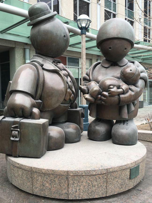 Immigrant family bronze sculpture