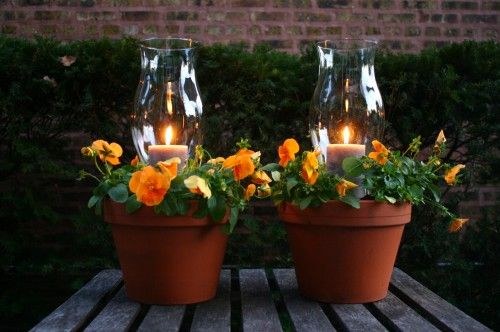 Potted Candle Planters - For an outdoor party try mixing your lighting with your plants…
