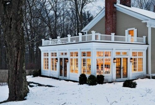 "Sunroom with walk out deck on top.  Create additional private outdoor seating area on roof of sun room.  ""How do you enjoy a sunroom in the middle of a Connecticut winter? Quite easily — with the help of heat and insulation, says James Crisp of Crisp Architects. 'Well-insulated windows, floors and ceilings can help make up for the large percentage of glass. Radiant floor heat and even conventional heat keep it warm inside, making it perfect for walking around in stockinged feet,' says…"