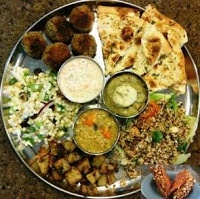 Middle Eastern Vegetarian Platter : Falafel with Carrot yogurt sauce, Lebanese Style Carrot Lentil Soup, Babaganoush with Pita chips, Potato Hara, Tabbouleh, Israeli couscous walnut salad, Irresistible Baklava.