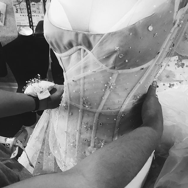 • DETAILS • A behind the scenes look into the @onedaybridal workroom • @domenica.a.pititto carefully placing lace onto @stephanie_onedaybridal wedding gown • #australianweddingdress #australiandesigner #weddinggown #onedaybridal #wedding #bride #insideoneday #patternmaker #lace  #Regram via @onedaybridal