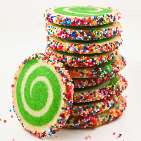 These colorful cookies from Sprinkle Bakescaught my eye last week as I  perused for something festive to bring to Christmas Eve dinner. Aren't they  pretty? The green swirl was fun for Christmas, but any color would be just  as fun. Bright yellow for a spring-time cookie? Orange for a Halloween  cookie? A swirl of colors for a birthday cookie?