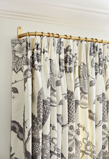 Euro pleat curtain panels returned to the wall. Returns are especially important in bedrooms to stop light from appearing round the sides of the curtains.