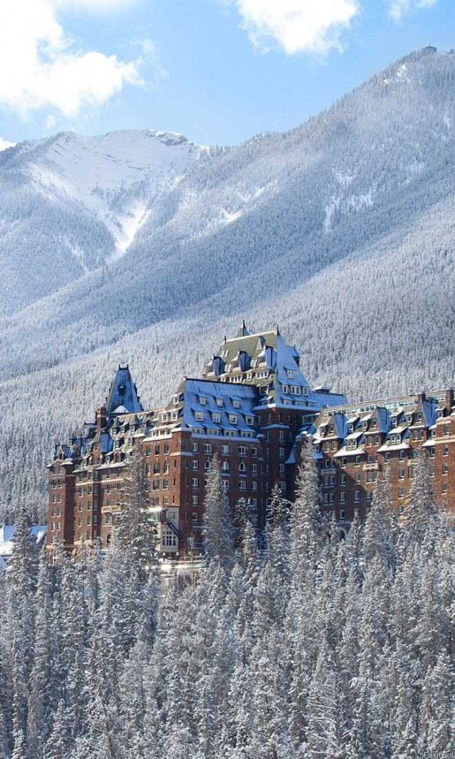 The Fairmont Banff Springs Hotel nestled in Banff, a quintessential Canadian ski…