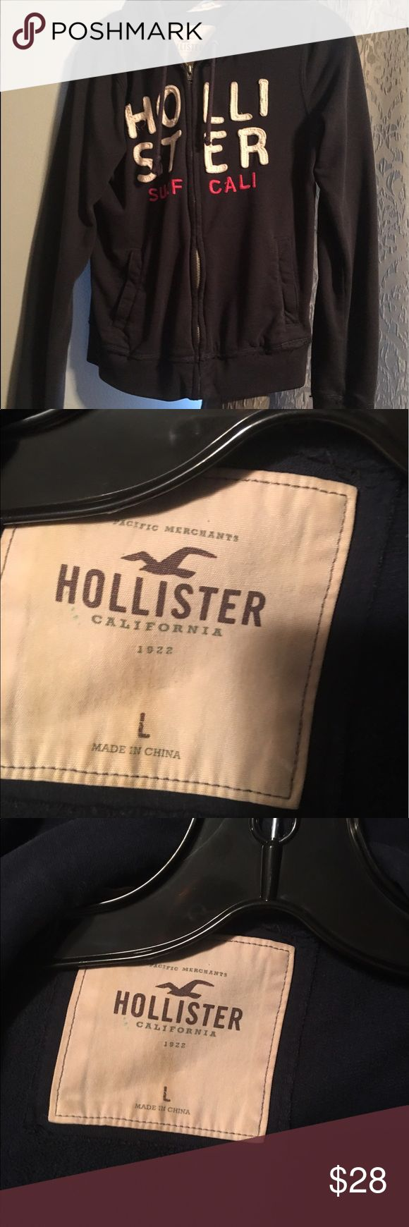 Zip up Hollister jacket. Navy blue. This jacket is a large, but it honestly fits like a small. I'm a size 2 and it fits me perfectly except the sleeves are a little long. It's been worn some. There's some discoloration on the tag. Hollister Jackets & Coats