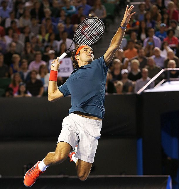Roger Federer jumping to hit a smash in a charity match at Rod Laver Arena. January 8, 2014