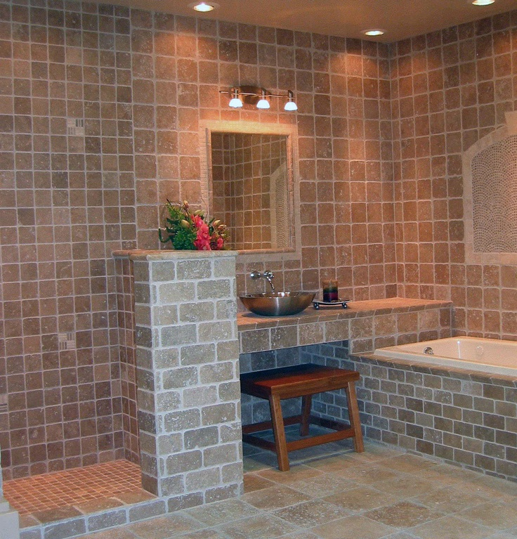 All travertine tile bathroom display. Think that brick but as a kitchen floor?
