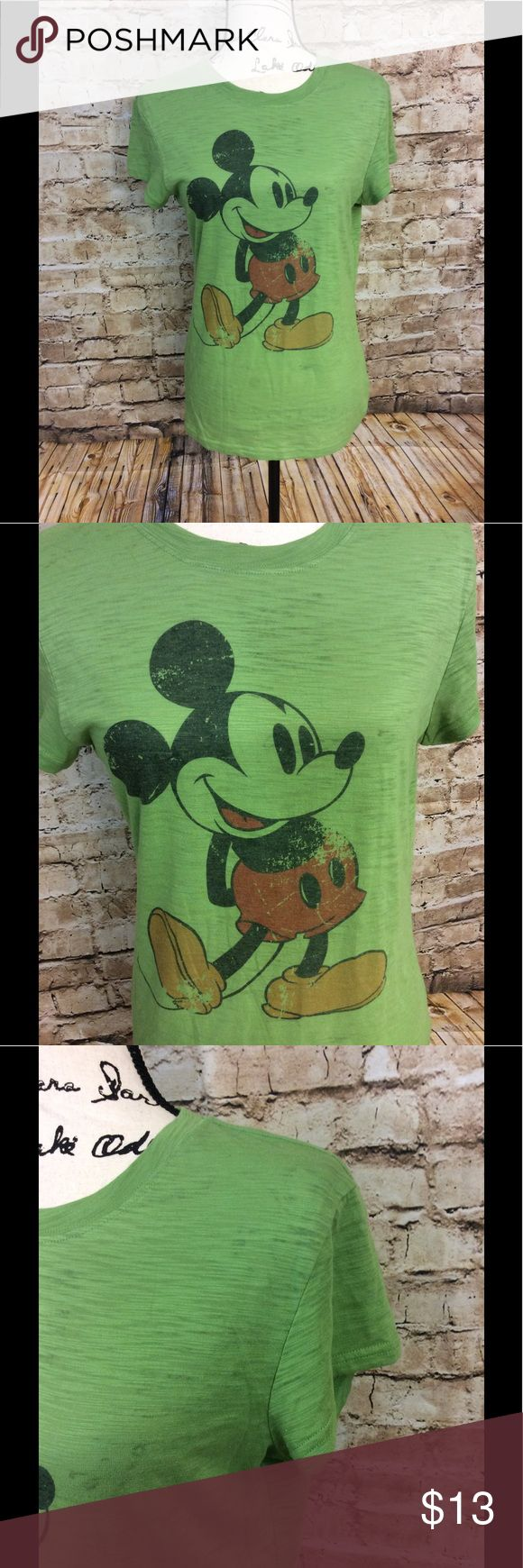 Disneyland green short sleeve Mickey Mouse T-shirt Very gently used green short sleeve Disneyland size large lightweight T-shirt vintage style with Mickey Mouse on the front Length from top to bottom is 26 inches 18 inches Disneyland Tops Tees - Short Sleeve