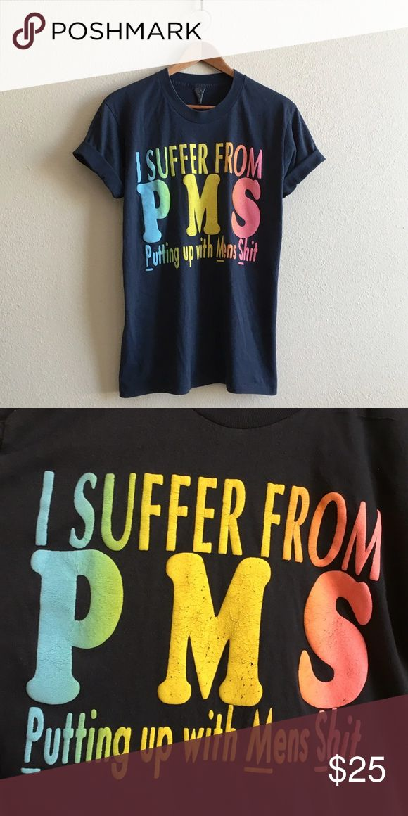 """Vintage PMS Joke Tee PMS """"Putting up with Men's Shit"""" funny gag-gift tee. Soft & thin, perfectly worn in. Something you would probably find in a convenience store circa 1986 💁🏻  BRAND: Center Stage? MATERIAL: 50/50 YEAR/ERA: 80s LABEL SIZE: L BEST FIT: M  MEASUREMENTS: Chest 20 inches  Length 27 inches   🚫 I do not model or trade, sorry! 💟 Check out my closet for more vintage tees! Vintage Tops Tees - Short Sleeve"""