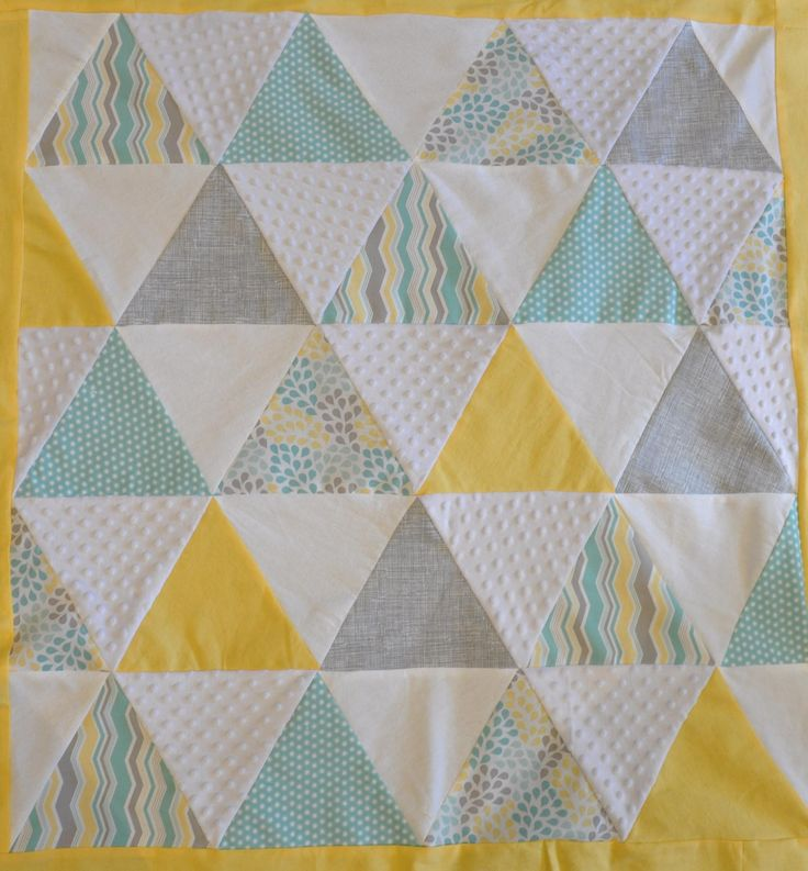 Pyramid triangle quilt in light green, grey / gray and yellow. Modern, geometric and uses flannel and minky fabrics.