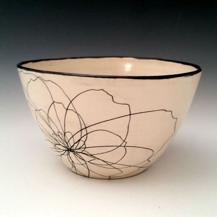 Peony Serving Bowl by Whitney Smith. This black and white bowl features an abstract peony flower design. It is first thrown on the wheel and then the flower design is hand carved on the porcelain clay, and highlighted with a black inlay. This bowl has an organic and sophisticated look that brings a simple beauty to the table. Its generous size makes it perfect for use as a salad, fruit, or pasta bowl, and is a beautiful bowl for your sideboard or table when not in use.