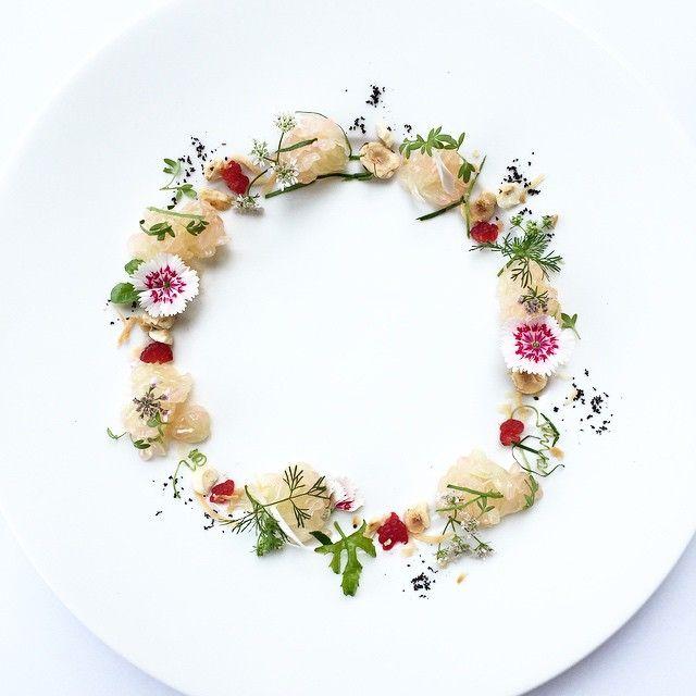 Pomelo salad • features pink pomelo, hazelnuts, shredded coconut flakes, raspberries, and kaffir lime leafs • สลัดส้มโอ ใส่ราสเบอรี่ มะพร้าวอบ ถั่วเฮเซลนัท ใบมะกรูดฉีก by royalebrat on IG #plating gastronomy