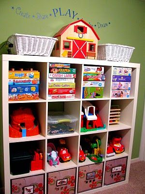 I dont like Ikea (I'm a firm believer in:  You get what you pay for)  but I love this open shelving system they have here.  It would work well in the Dean Girls playroom.
