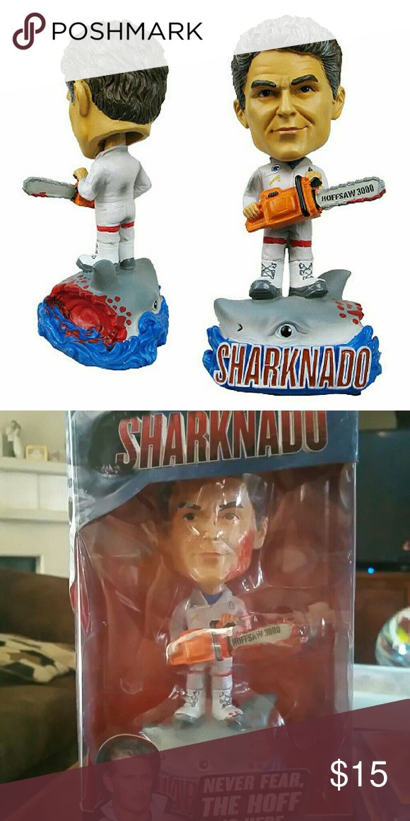 Sharknado vs The Hoff Sharknado vs. The Hoff Bobble Head: Commemorate the popular Sharknado film series! This Sharknado vs. The Hoff Bobble Head features David Hasselhoff as seen in the Sharknado 3: Oh Hell No movie from SyFy, wielding an electric chainsaw and standing on top of a dismembered shark's head. It's a must-have for Sharknado fans! Measures approximately 7-inches tall. Sharknado Other