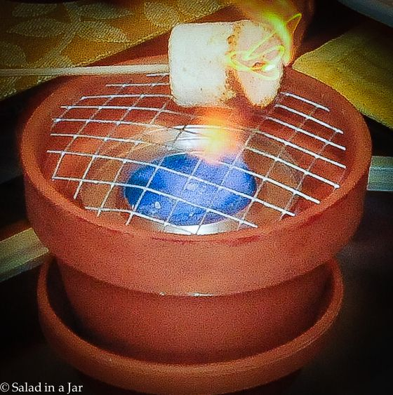 Clay pot, wire, sterno and you have a table top grill, perfect for smores.