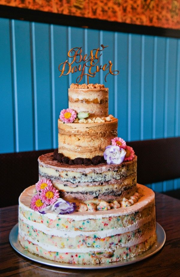 Peanut butter, cookies and cream, and confetti wedding cake by Momofuku Milk Bar   Photo by Kate Edwards Weddings