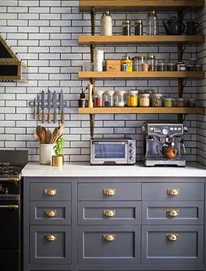 Wood open shelves with brass brackets