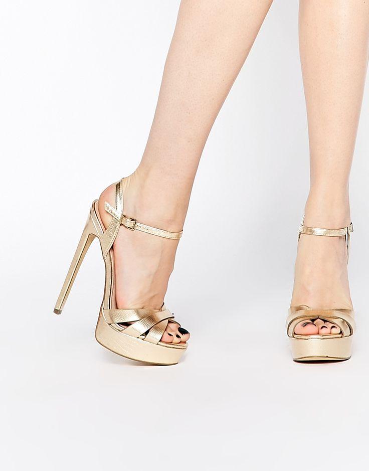 Image 1 ofRiver Island 70'S Glam Gold Platform Heels
