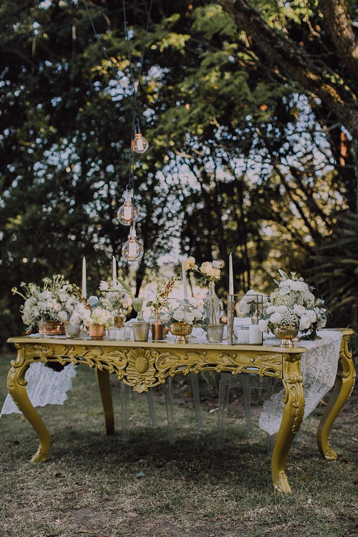 Andrew & Jill's Relaxed Outdoor Wedding at Hawksmoor House Wedding Venue – Stellenbosch  Their tables were adorned with gold accents, white flowers, gold cutlery and vintage lace runners.  I love the colour of this vintage bridal table!