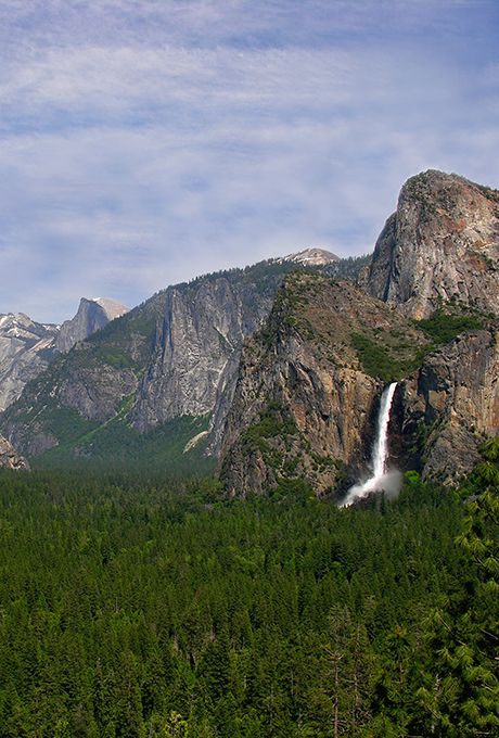 """Best Spring Honeymoon Destinations: Tenaya Lodge, Ahwahnee Hotel in Yosemite National Park  Yosemite National Park  They call it """"waterfall season,"""" when the snowmelt rushes from the mountaintops to the streams. We call it paradise. Wildflowers burst from the rocks, meadows are lush with fresh grass, and the dogwoods light the whole place in twinkling white blossoms. Added bonus: Stay in the park (the Tenaya Lodge and Ahwahnee Hotel are right there) and you just might see a moonbow (lunar…"""