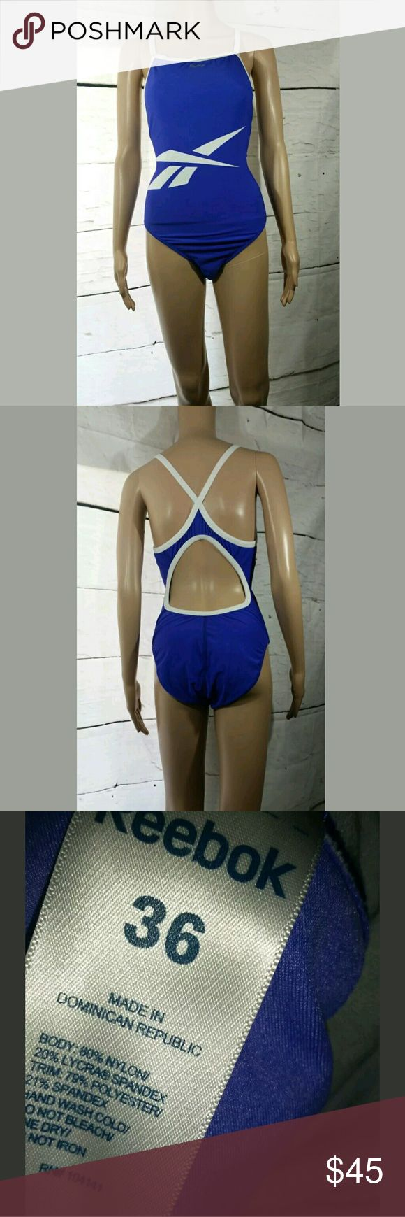 Reebok One Piece Swimsuit Cut Out Back Reebok One Piece Swimsuit Cut Out Back Purple White 36 / Large  Excellent used condition. Size 36/ Large.  AB Reebok Swim One Pieces