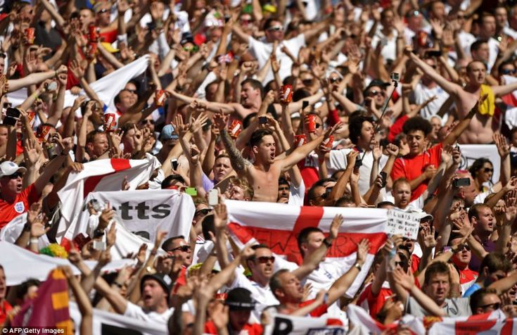 Come on you England: Fans in Brazil show their supoort for the team, despite today's game being a dead squib