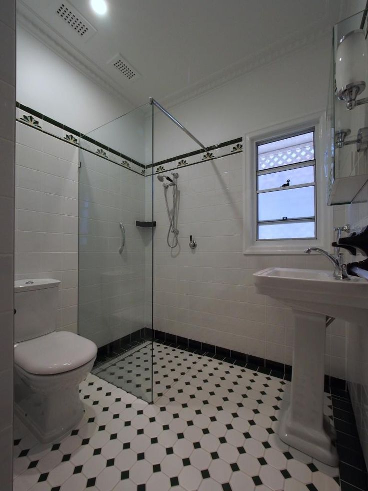 Toilet suite, shower screen, pedestal basin.  Art deco mosaic floor and wall tiles.  Brodware tapware.