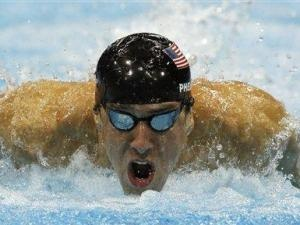Michael Phelps won the 100-meter butterfly at the London Games on Friday for the record 17th gold and 21st medal overall in his Olympic career.